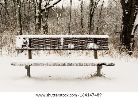 Alone park bench at the park in the Winter - stock photo