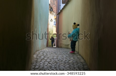 Alone sad child lost on a street - stock photo