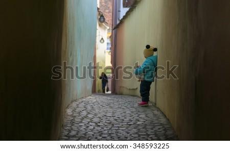 Alone sad child lost on a street - stock photo