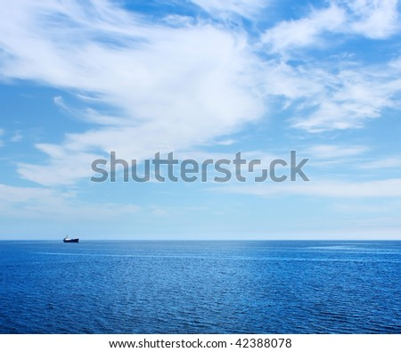Alone ship in blue sea - stock photo