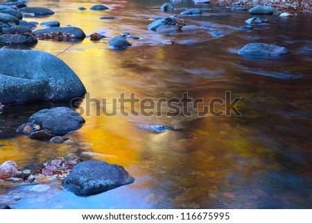 Alone stone in the water - stock photo