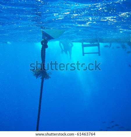 Alone swimmer in sea abyss - stock photo