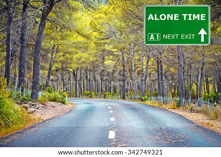 ALONE TIME road sign against clear blue sky - stock photo