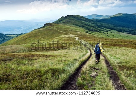 alone tourist in high mountain - stock photo