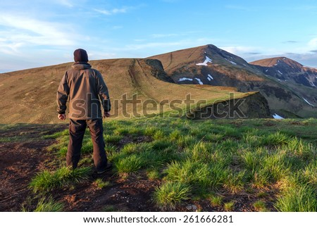 alone tourist on mountain top - stock photo