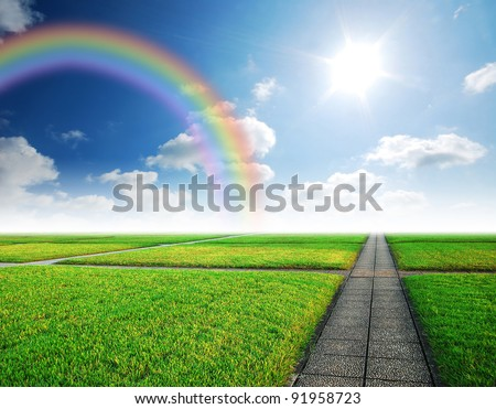 Alone way green grass cloudy blue sky to destination and green way to the future rainbow - stock photo