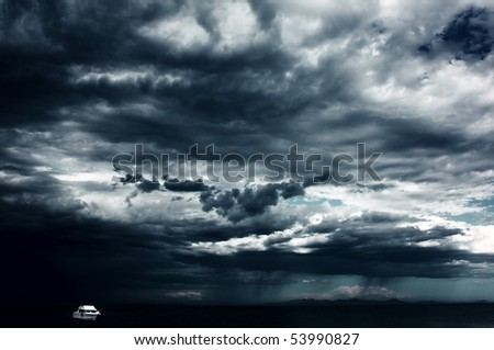 Alone white little boat on sea and dark storm clouds - stock photo