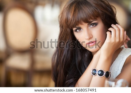 Alone woman in cafe, sad beautiful girl. Attractive bored woman in restaurant. Beautiful young woman dining at restaurant. - stock photo