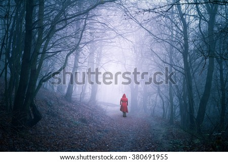 alone woman in dark forest - stock photo
