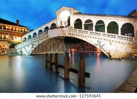 Along Rialto Bridge, Venice at dramatic sunset - stock photo
