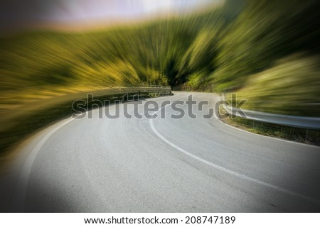 Along the road with motion blur in the nature - stock photo