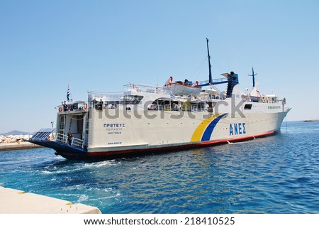 ALONISSOS, GREECE - JUNE 23, 2013: Anes Lines ferry Proteus docking at Patitiri harbour on the Greek island of Alonissos. The 87.91mtr ship was built in Greece in 1973. - stock photo
