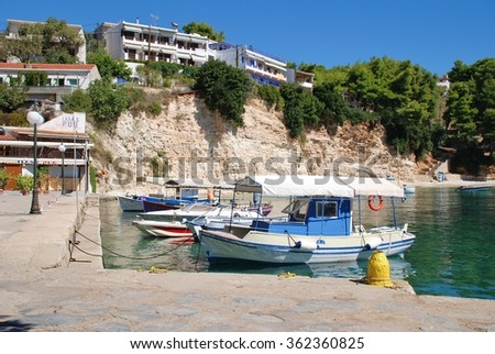 ALONISSOS, GREECE - SEPTEMBER 23, 2012: Boats moored in the harbour at Votsi on the Greek island of Alonissos. The village lies just to the North West of Patitiri, Capital of the island.