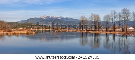 Alouette River and Mountain Golden Ears in early winter - stock photo