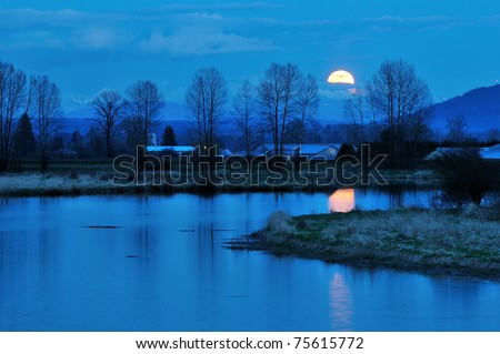 Alouette River Moonrise, Pitt Meadows, British Columbia - stock photo