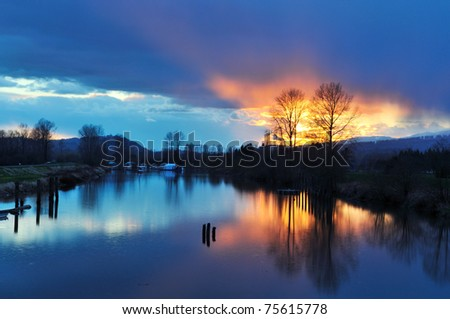 Alouette River Raining Sunset, Pitt Meadows, British Columbia - stock photo