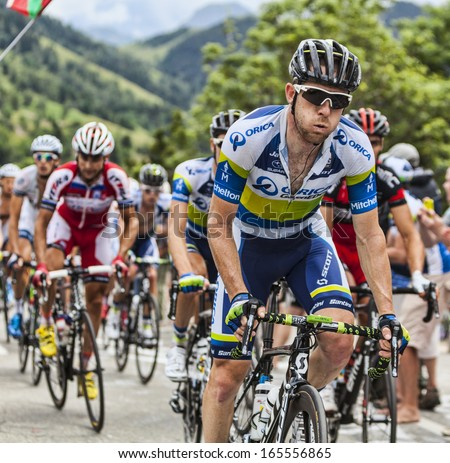 ALPE D'HUEZ, FRANCE, JUL 18:The Australian cyclist Matthew Harley Goss from Orica-GreenEDGE Team climbing the difficult road to Alpe-D'Huez, during the stage 18 of Le Tour de France on July 18 2013 - stock photo