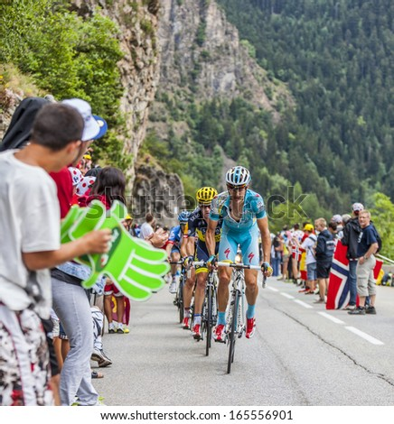ALPE D'HUEZ, FRANCE, JUL 18:The Danish cyclist Jakob Fuglsang from Astana Team climbing the difficult road to Alpe-D'Huez, during the stage 18 of the edition 100 of Le Tour de France on July 18 2013