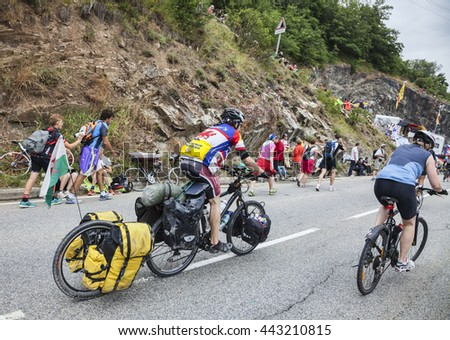 ALPE D'HUEZ, FRANCE, JUL 18: Unidentified amateur cyclotourists climbing up the road to Alpes d'Huez before the apparition of the cyclists during the stage 18 of Le Tour de France on July 18 2013