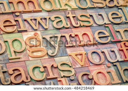 alphabet abstract background - random letters in letterpress wood type printing blocks