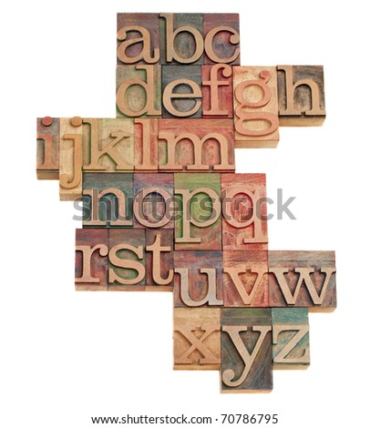 alphabet - abstract of vintage wooden letterpress printing blocks stained by color inks, isolated on white - stock photo
