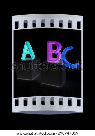alphabet and blocks on a black background. The film strip - stock photo
