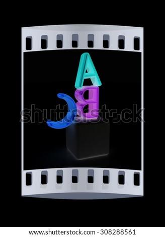 alphabet and blocks on a black background. The film strip - stock photo