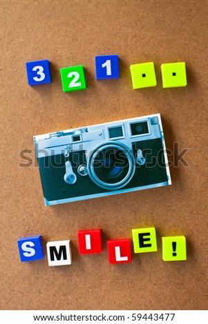 alphabet and camera made by plastic on wood board,for you - stock photo