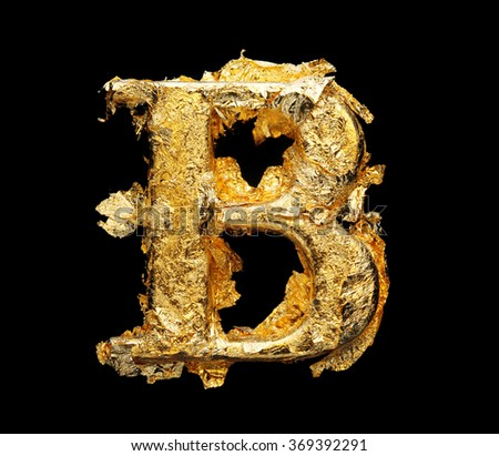 Alphabet and numbers in rough gold leaf isolated on black - stock photo