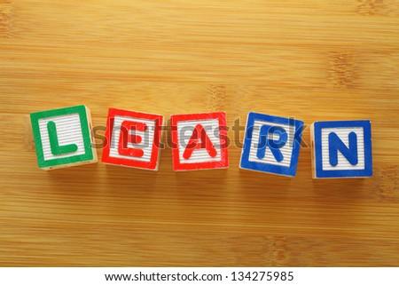 Alphabet Block spell the word learn - stock photo