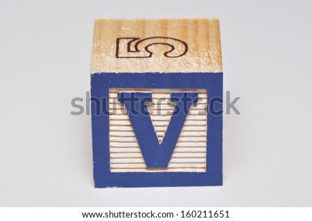Alphabet block V isolated on a white background - stock photo