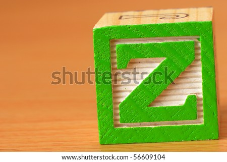 Alphabet block with a green letter Z