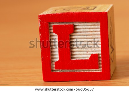 Alphabet block with a red letter L - stock photo
