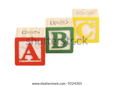 Alphabet blocks lined up to spell abc - isolated on white - focus on A block - stock photo