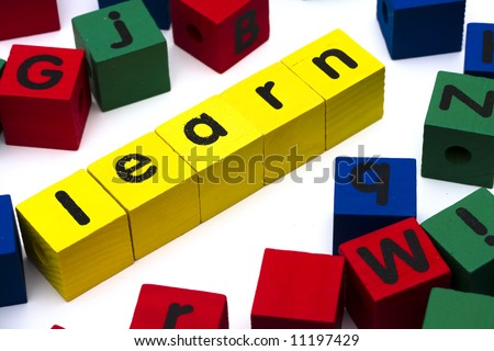 Alphabet blocks spelling learn on white background - stock photo