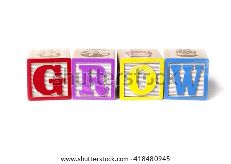 Alphabet blocks spelling the word Grow, isolated on white background.