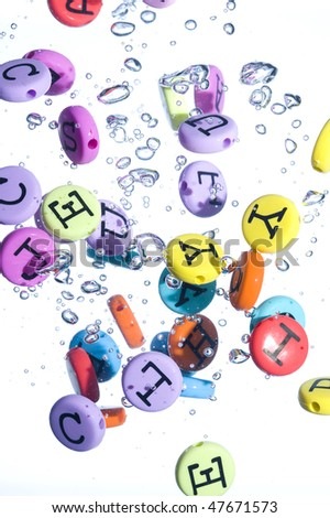 Alphabet colored background. Button with splashing water