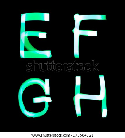 alphabet created with light (E, F, G, H) - stock photo