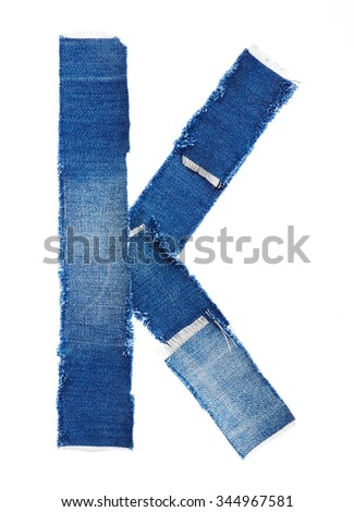 Alphabet from jeans fabric isolated on white background. Letter K - stock photo
