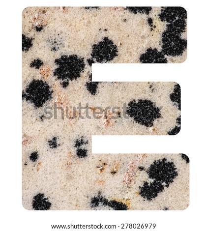 Alphabet from mineral porphyry  isolated on white background -  letter E. - stock photo