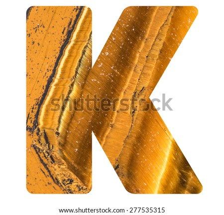 Alphabet from mineral tiger eye  isolated on white background -  letter K. - stock photo