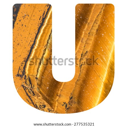 Alphabet from mineral tiger eye  isolated on white background -  letter U. - stock photo