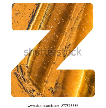 Alphabet from mineral tiger eye  isolated on white background -  letter Z. - stock photo