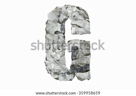Alphabet G, created by a group of stone isolated on white background