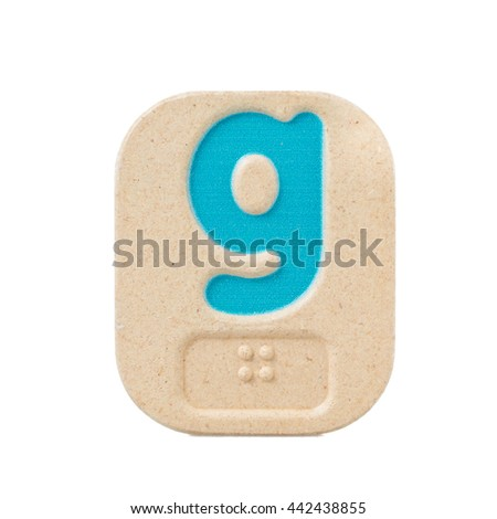 alphabet g on white background  with Braille. - stock photo