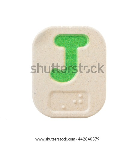 alphabet J on white background  with Braille. - stock photo