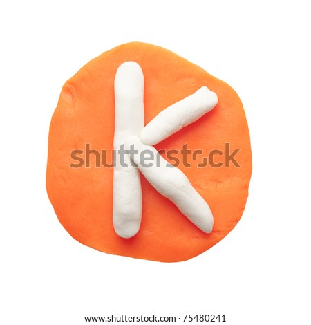 Alphabet letter using plasticine and clay. Letter K - stock photo
