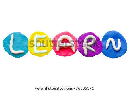 Alphabet letter using plasticine and clay to form word LEARN - stock photo