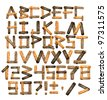 Alphabet - letters from wooden boards and bark - stock photo