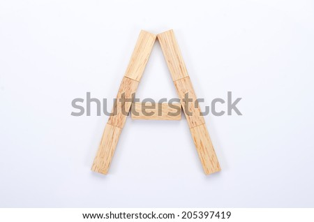 Alphabet letters of wooden toy blocks isolated on white background. - stock photo